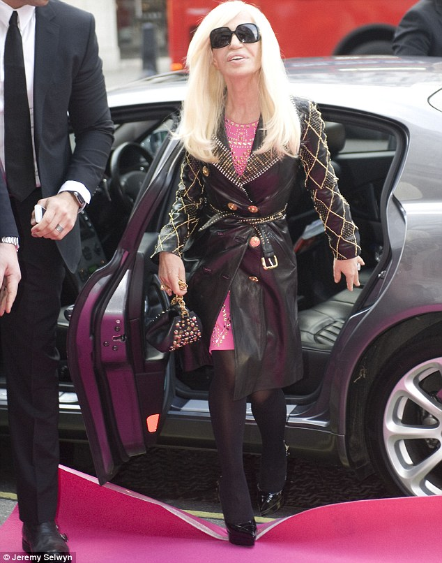 Donatella Versace arrives at the H&M store on London's Regent St to celebrate the launch of her collection for H&M