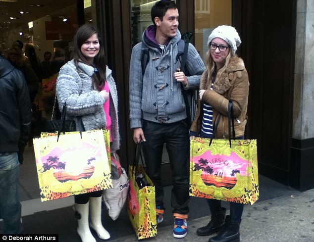 Devoted: From left, Stephanie O'Reilly, 22, Alan Murrell and Laura Scott, both 21, were first in line, having queued since 10pm the previous night