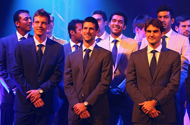 Master and apprentice: The legendary Roger Federer (right) had a word of warning for the in-form Murray