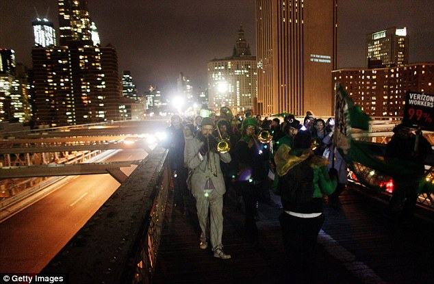 Rally: The march continued across the historical bridge's pedestrian promenade featuring musical instruments and parade floats