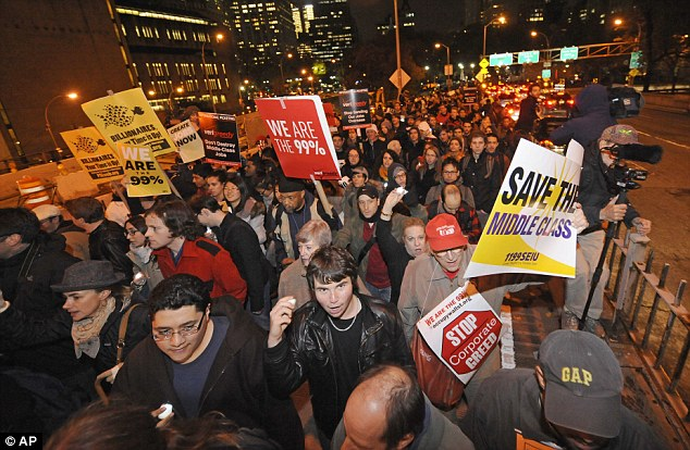 'Day of action': Occupy Wall Street protesters and union members walk across the Brooklyn Bridge after a rally in Foley Square today in New York