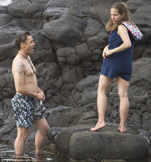 Wow: Downey looks animated as his wife begins to change out of her blue swimsuit to reveal her bikini underneath