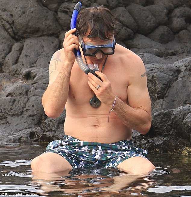 Ducking and diving: The Iron Man star has his goggles and snorkel in place as he goes for a swim