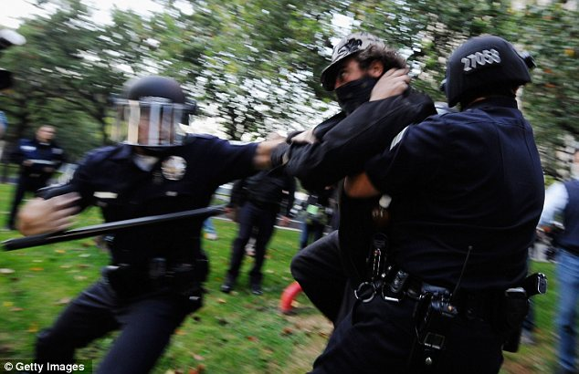 Occupy Los Angeles: A protester was hauled to the ground by LAPD officers during the Day of Action last week