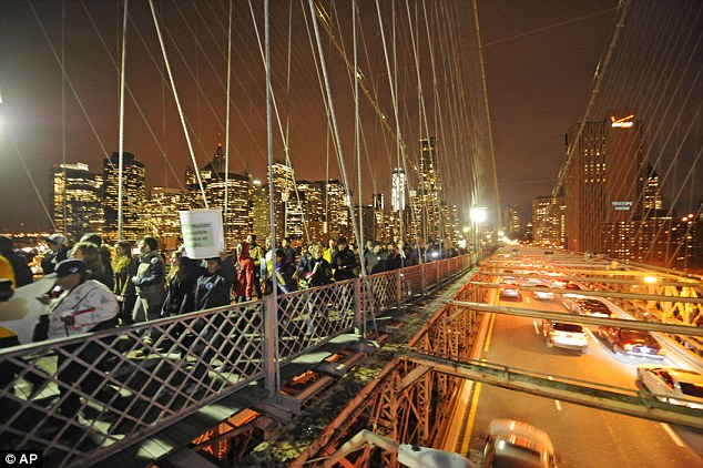 Invasion: Six months ago Occupy protesters marched across the same path and bridge but in much heavier numbers