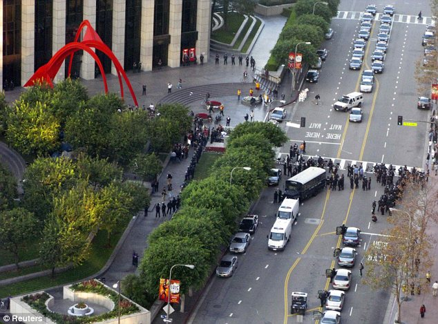 Occupy Los Angeles: A contingent of LAPD officers gathered in the street at the Bank of America Plaza yesterday