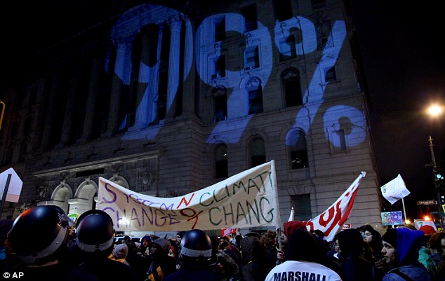Illuminated: A 99% light projection was cast on a building as Occupy Wall Street protesters marched through the night
