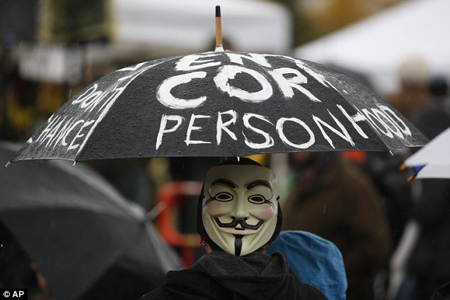 Occupy Seattle: Protesters pictured waiting for the march to begin for the 'National Day of Action' yesterday