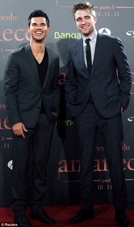 Here come the boys: Robert Pattinson (right) and Taylor Lautner (left) at the Breaking Dawn premiere in Barcelona, Spain last night
