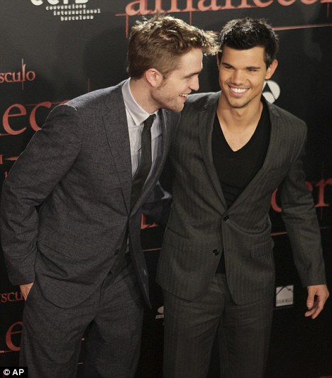 Having a laugh: The two co-stars joke around on the red carpet in Barcelona, Spain