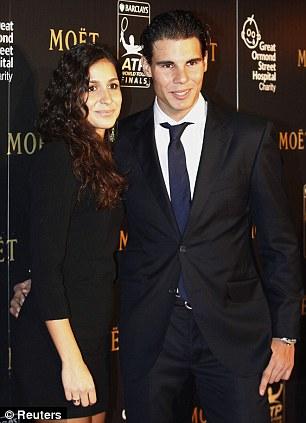 Stunning: Rafael Nadal and girlfriend Maria Francisca Perello