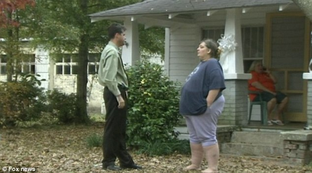 Horrifying discovery: Samantha West talks to a local reporter outside her home in Chadbourn, North Carolina where she found her daughter hanged