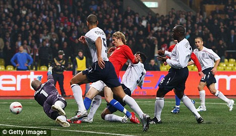 Russia with love: Roman Pavlyuchenko scores against England on a plastic pitch in Moscow in 2007