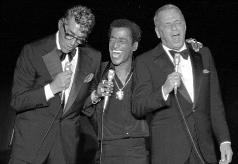 Crooners: Sinatra (right) alongside fellow 'Rat Pack' members Dean Martin, left, and Sammy Davis Jr. Sinatra was allegedly furious after Davis played a copy of the porn film at a party