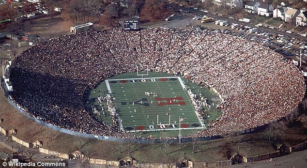 Big crowd: The Yale versus Harvard game, held at the Yale Bowl in New Haven, Connecticut, was expected to attract 50,000 fans. Pictured is a previous match between the universities