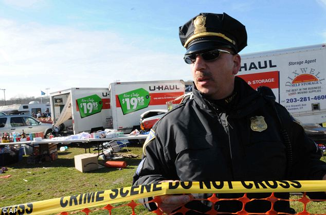 Taped off: New Haven and Yale Police roped off the scene of the accident involving the U-Haul trucks at Yale Bowl Lot D