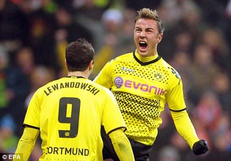 Rising star: Mario Goetze (right) celebrates scoring against Bayern