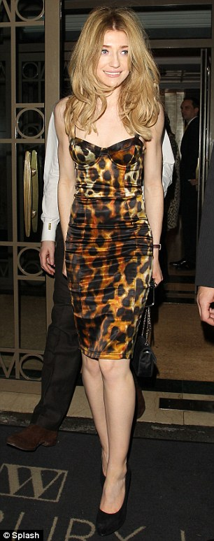 Who's got the highest heels? Walsh was joined at her party by Girls Aloud bandmate Nicola Roberts, who looked lovely in a leopard-print corset dress