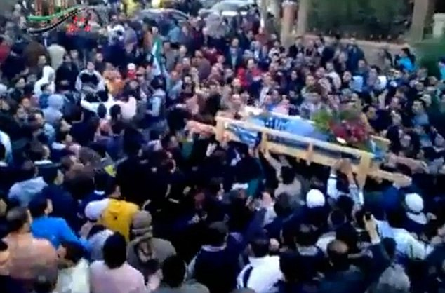 Mourners: 20,000 people attended Mohammed's funeral after news of his brutal killing spread