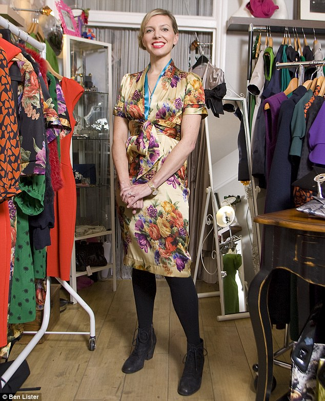 Suzannah in her tiny West London boutique wearing one of her own designs (print day dress, £395)