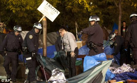 Police officers order Occupy Wall Street protesters to leave Zuccotti Park, their longtime encampment in New York