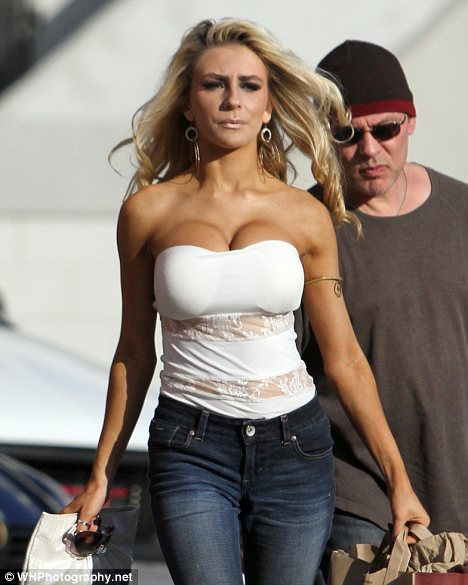 Is that your dressed down look? Courtney Stodden covered up in a pair of jeans as she and husband Doug Stodden took some clothes to a charity shop