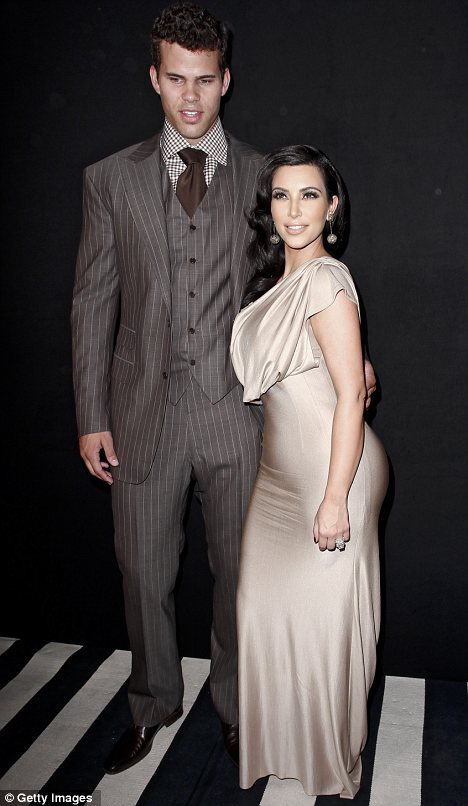 Did you just say that? Kris is accused of slamming Kim's curvy derriere, seen here in happier times before their split