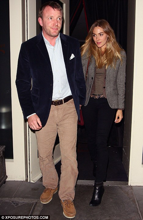 Dressed to thrill: The film director and his girlfriend looked great together
