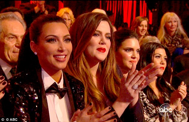 Round of applause: Kim, Khloe, Kendall and Kourtney clap enthusiastically as Rob achieved his first perfect score of the season