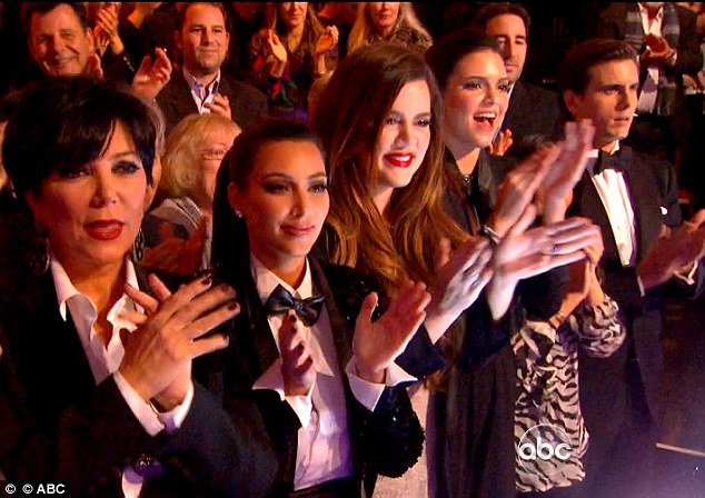 'We're all in tears': Kim has been notably absent in recent weeks, but finally made her comeback tonight along with sisters Khloe, Kendall, Kourtney (obscured) and Scott Disick