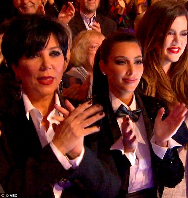 She's back: Kim Kardashian returned to the Dancing With The Stars audience tonight and watched on as brother Rob topped the leader board, pictured here with mother Kris Jenner in matching jacket and shirts
