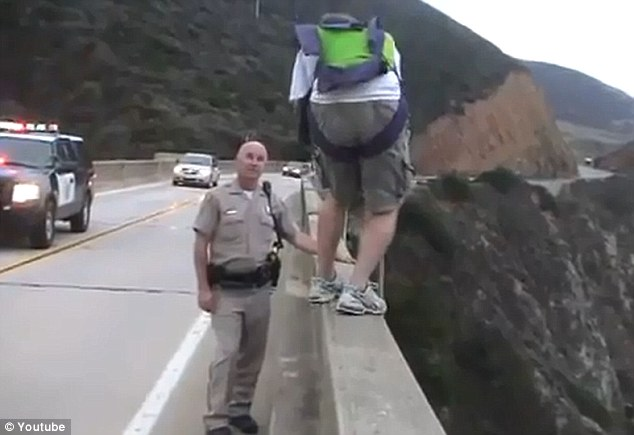 Hand shake? The base jumper attempted a truce with the officer by shaking his hand but the officer wasn't interested