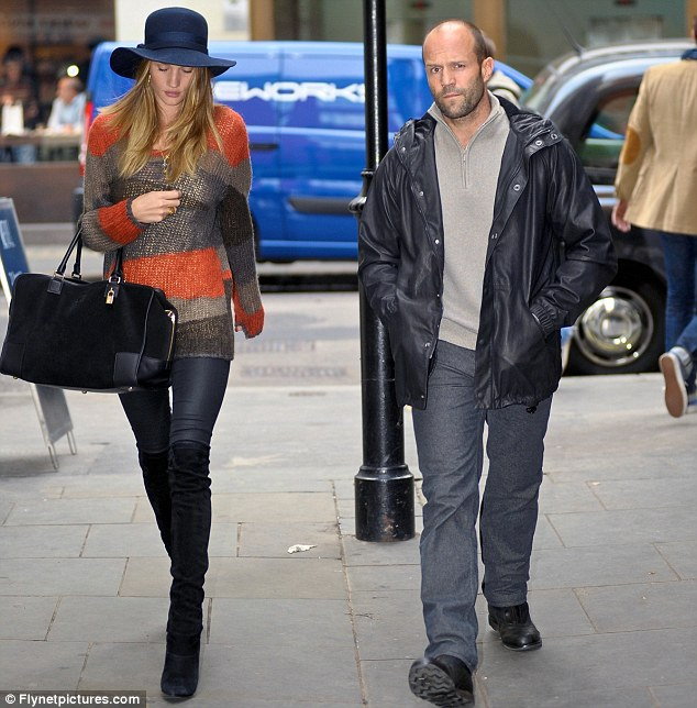 A love match: Rosie is happily dating and living with British action star Jason Statham