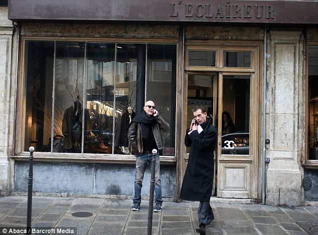 Shopping spree: The Die Hard star waited for transport outside a French clothing store