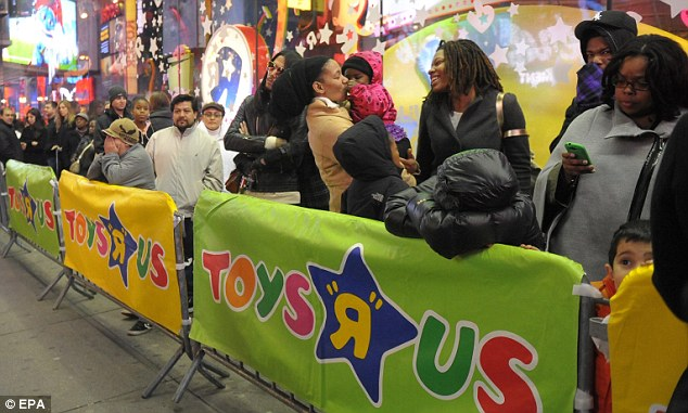 Early start: Analysts believe the increase could be thanks to shops opening on Thursday for the first time. Toys R Us opened at 9pm on Thanksgiving Day in a bid to entice early shoppers, as did Walmart