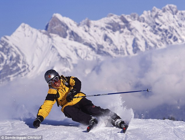 A skier carves his way down the slopes