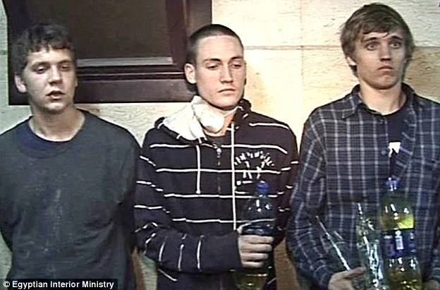 Escape from Egypt: (left to right) Derrik Sweeney, 19, Luke Gates, 21, and Gregory Porter, 19, were arrested on Sunday on the roof of a university building near Tahrir Square but have now been released
