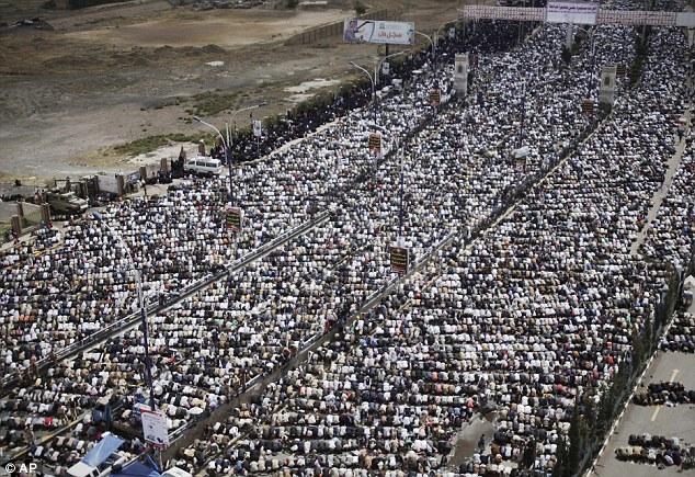 Prayer time: Yemeni protestors attend Friday prayers during a demonstration demanding the prosecution of Yemen's President Ali Abdullah Saleh