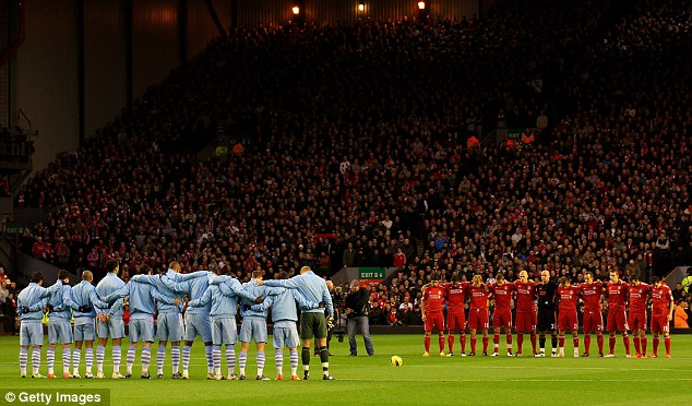 Respect: The Kop falls silent as Manchester City and Liverpool players pay their respects to Gary Speed before their Premier League match
