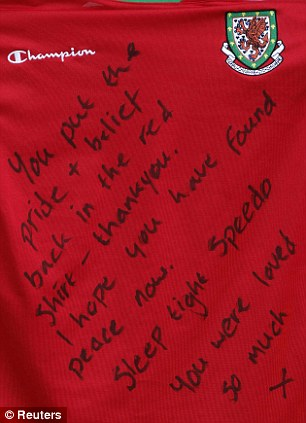 Respect: A note left on a Wales shirt outside Cardiff City's stadium