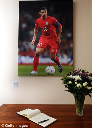 Respects: A book of condolences in memory of Gary Speed is opened at the Football of Wales offices in Cardiff