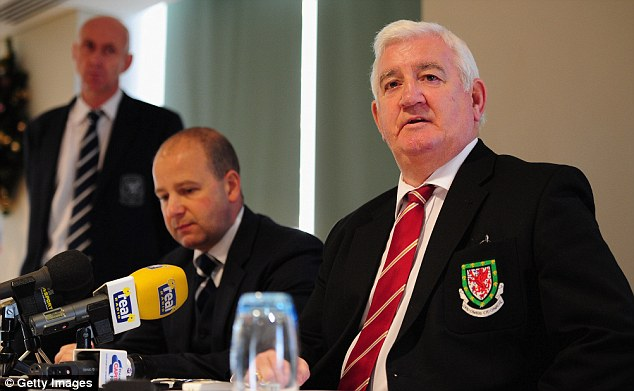 Tragedy: Chief executive of the Football Association of Wales Jonathan Ford and President of the Football Association of Wales, Phil Pritchard, tell a press conference they will be supporting Gary Speed's family in the coming days