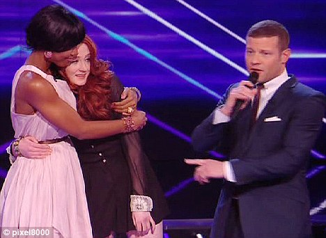 Heartbreak: A distressed Kelly hugs her act Janet Devlin after the Irish singer got booted off the X Factor