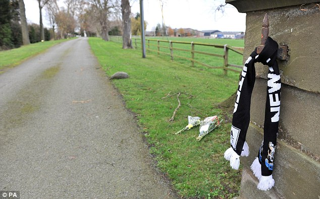 Never forget: A Newcastle scarf is tied to the entrance to his Cheshire home