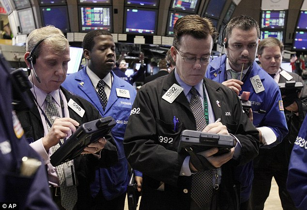 Back up: Wall Street stocks soared on optimism over the latest European proposals to sort out the growing euro zone debt crisis. Traders are pictured on the floor of the New York Stock Exchange today
