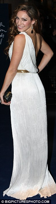Flashing the flesh: Kelly teamed the pretty dress with a pair of animal-print heels and a gold belt
