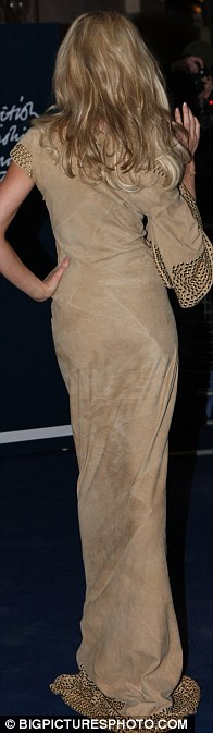 Where's your baby weight gone? Abbey looked slender as she posed for photographers outside the awards
