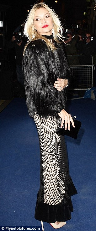 Hoping to catch something? Kate Moss arrived for the ceremony wearing an unusual netted dress
