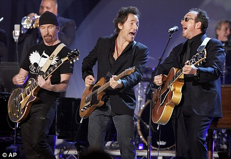 On stage: Costello (right) performing with The Edge (left) and Bruce Springsteen (centre) at the 2006 Grammy Awards in LA