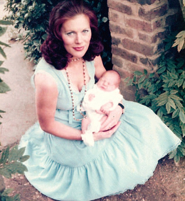 Proud mother: Paulette Moray, aged 30, holds her newborn son Sasha in 1977 some four years before he was snatched by his father